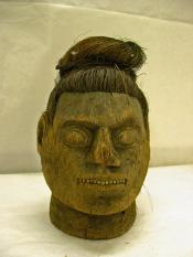 Carved head, female