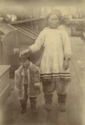 Photograph of Inuit woman and child on deck of ship