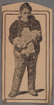 Photograph clipped from a newspaper: young girl in furs