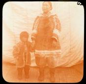 Inuit mother and child on the deck of a whaling ship