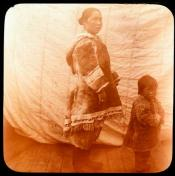Inuit mother and child on the deck of a ship