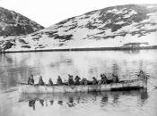 A number of Inuit in an omiack or large skin boat