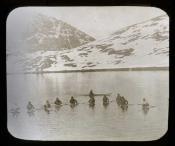 Eleven Inuit in kayaks, Greenland
