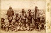 group of twelve Inuit, men women and children