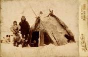 Inuit family outside skin tent