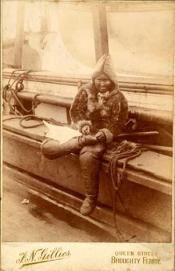 Inuit woman mending shoes
