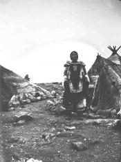 Eskimo woman in camp