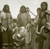 Group of Inuit women and children on the deck of a whaling ship