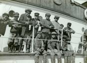 Group of Inuit boys at the rail of a whaling ship