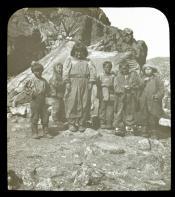 Inuit children outside skin tent