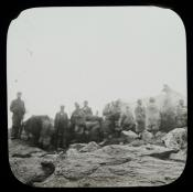 Group of Inuit standing on rocks