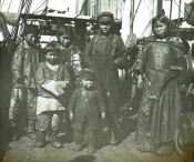 Group of Inuit children standing on the deck of a whaling ship