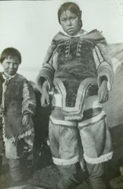 Two Inuit children in indigenous clothes