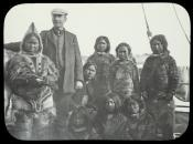 View of whaling seaman with group of Inuit
