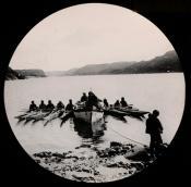 Inuit kayaks alongside a ship's boat