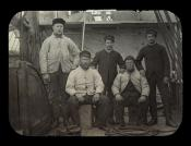 Group of five seamen on the deck of a whaling ship