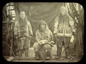 Three Inuit on deck of a whaling ship