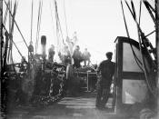 Members of crew standing on the deck of a whaling ship