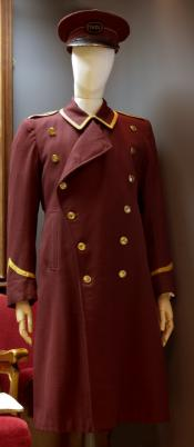 Long maroon coat with epaulettes and gold ribbon trim
