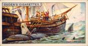 Ogdens cigarette cards, whaling series. 25 in the series.  8. Cutting In