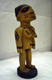 Carved female 'ibeji' figure